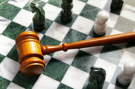 judges law gavel on a chess board, from above photo