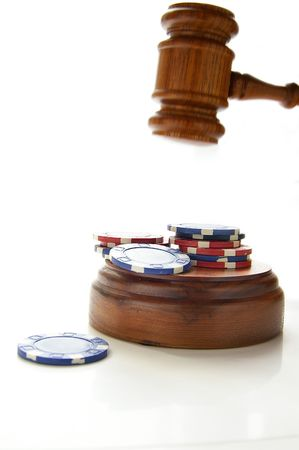 arbitrater: judges law gavel and poker chips, on white