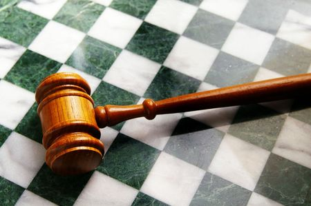 judges wooden gavel on a chess board
