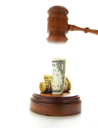 judges gavel about to pound on money Stock Photo