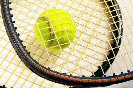 tennis racket strings and tennis ball, closeup Stock Photo