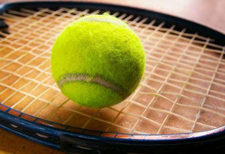 closeup of a tennis ball on racket strings Stock Photo