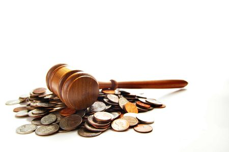 arbitrater: judges law gavel on a pile of coins, over white