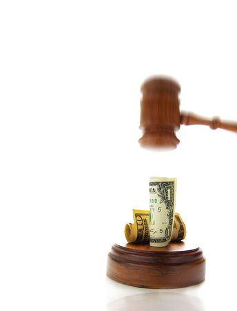 arbitrater: judges law gavel about to pound on money