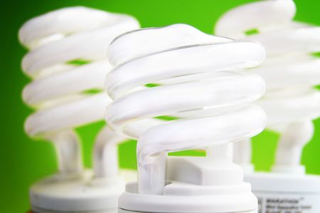 environmentalism: energy efficient light bulbs on green background