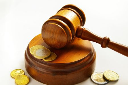 assorted euro coins and judges court gavel Imagens