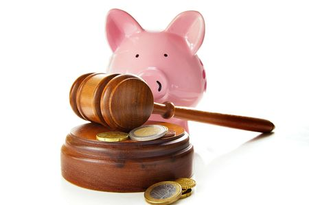 assorted euro coins with court gavel and piggy bank Stock Photo