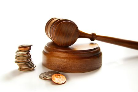 judges court gavel and assorted coins, on white Stock Photo