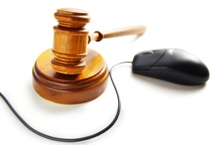 computer mouse and court gavel, on white photo