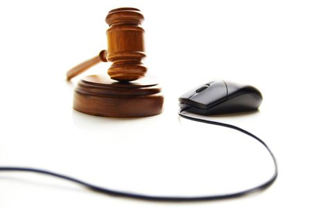 computer mouse and judges court gavel, on white photo