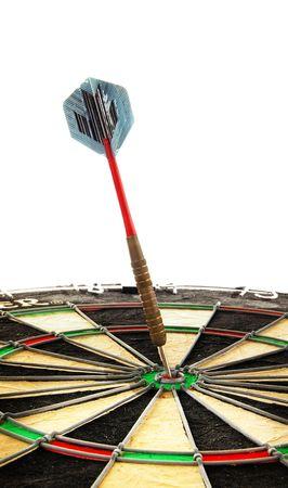 a dart hitting the bullseye, over white