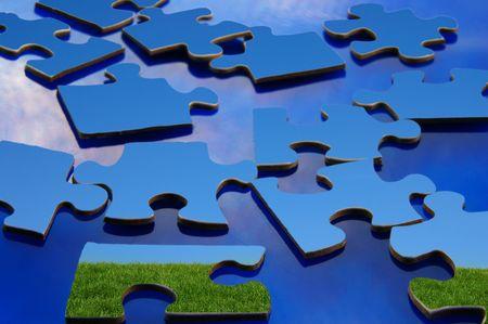 緑の草に覆われた丘と青空のパズルのピース