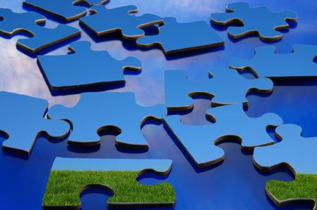 Puzzle pieces of green grassy hill and  blue sky