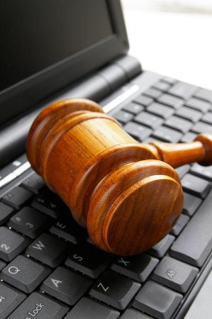 closeup of a gavel on a computer photo