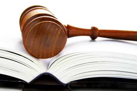 gavel laying on a an open law book Stock Photo