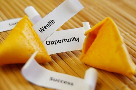 closeup of a fortune cookie with Success, Opportunity etc messages Banco de Imagens