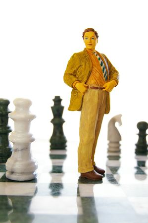 business man figure standing on a chess board Stock Photo - 6173973