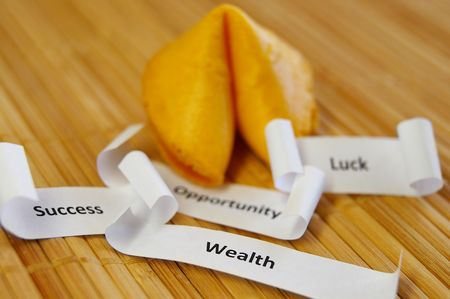 closeup of a fortune cookie with Success, Wealth, Opportunity messages Stock Photo - 6173967