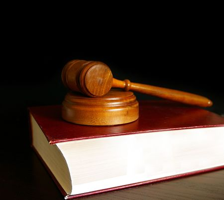 judges court gavel sitting on a law book