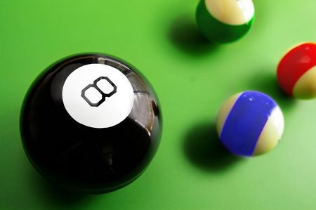 assorted billiard balls, with macro 8 ball, from above