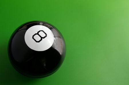 closeup of a billiard 8 ball on a pool table