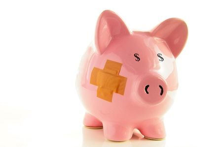 healthcare costs: Piggy bank with bandage, metaphor for healthcare costs