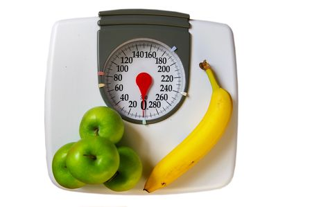 apples and banana on a scale (healthy diet)