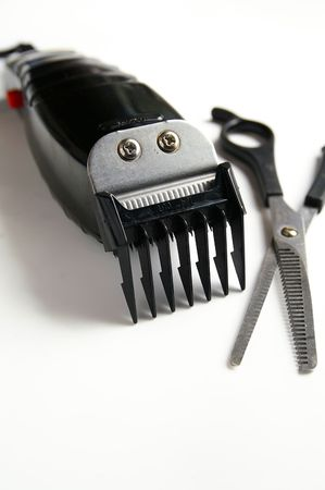 trimmers: barbers hair clippers and scissors, on white Stock Photo