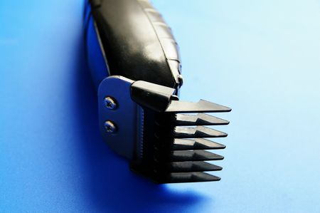 trimmers: closeup of electric barber clippers, on blue Stock Photo