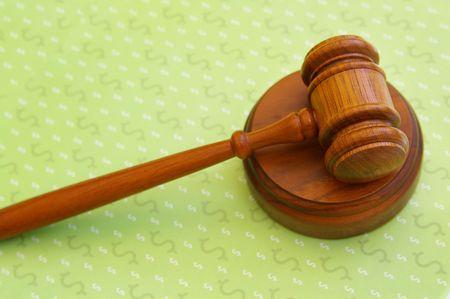 arbitrater: judges court gavel over dollar sign pattern