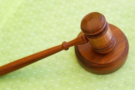 judges court gavel on dollar sign pattern