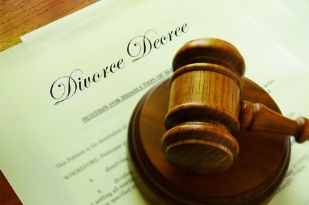 Legal gavel on top of divorce papers photo