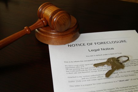 homeownership: foreclosure document with house keys and court gavel