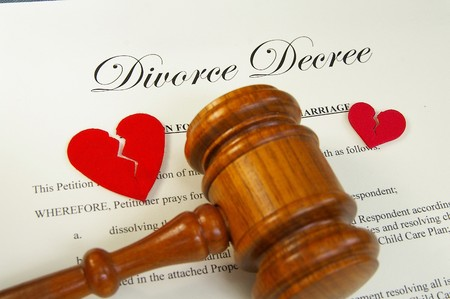 broken red hearts and legal gavel on divorce papers photo