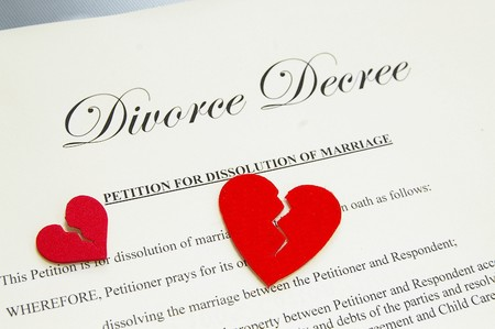 small broken red hearts on divorce papers Stock Photo - 7560904