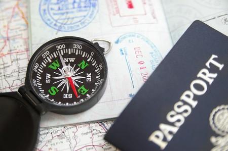 compass on a US passport and map 版權商用圖片