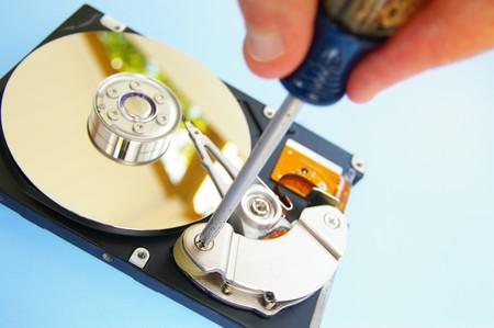 pc technician repairing a computer hardrive Stock Photo - 7833680