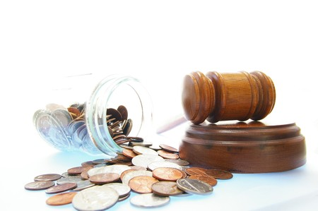 bankrupt: court gavel and coin jar, on white - lawsuit or divorce concept