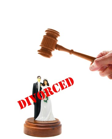 arbitrator: wedding couple figures and court gavel, on white Stock Photo