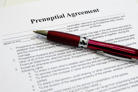 a prenuptial marriage contract and pen Stock Photo