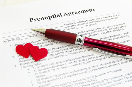 prenuptial agreement with two red hearts Stock Photo
