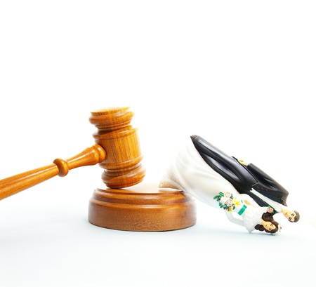 divorce court: plastic wedding couple and legal gavel (divorce concept)