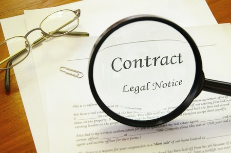legal contract with magnifying glass and glasses Stock Photo - 7969149