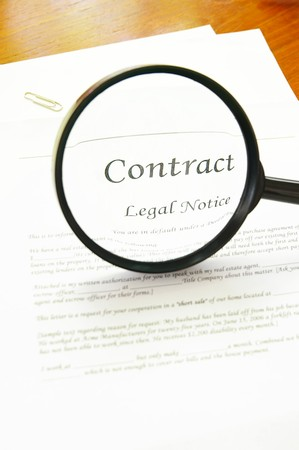 contractual: legal contract and magnifying glass