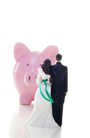 fake money: cake-topper wedding couple and piggy bank( money troubles concept )