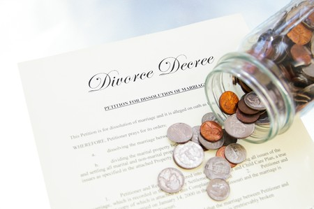divorce legal document and spilled coin jar