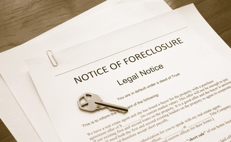 home foreclosure legal document with house key photo