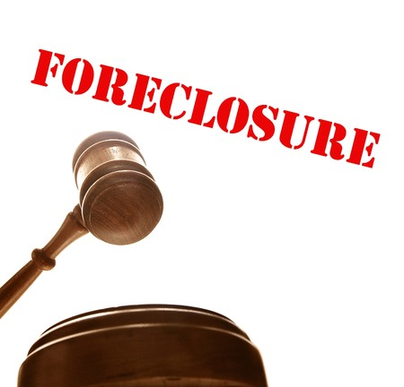 sue: judges court gavel with foreclosure text, on white