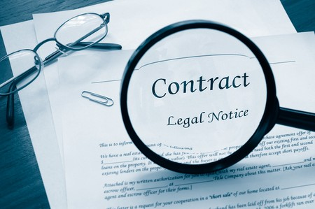 contractual: legal contract with magnifying glass and glasses
