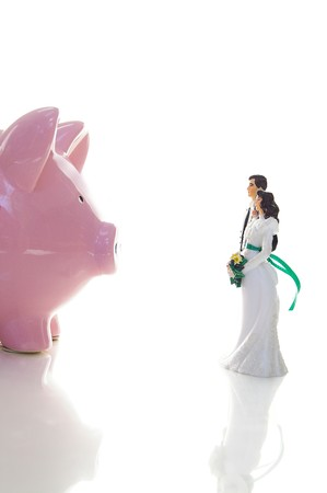 wedding couple and piggy bank ( financial troubles concept ) Stock Photo - 8074962